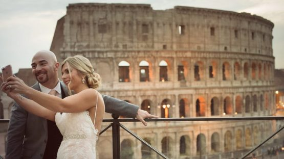 Colosseum view bride and groom from Palazzo Manfredi Rome