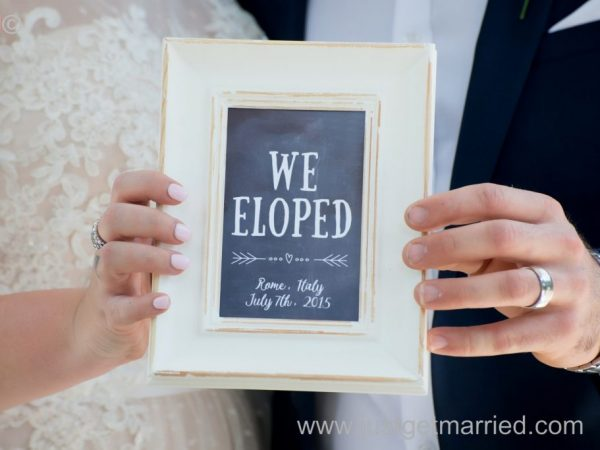 elope in Italy photo frame bride and groom hands