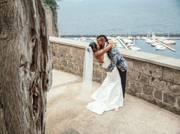 Villa Fondi Wedding couple kissing with Sorrento's port view
