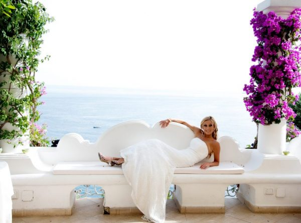Positano Terrace, bride on white bench with panoramic view Italy