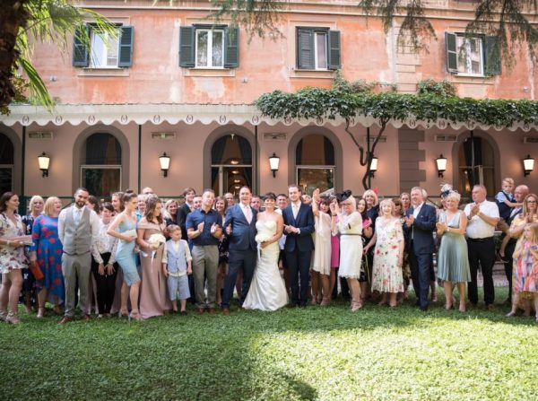 Garden Ceremony at Hotel Quirinale in Rome, group photo with bride and groom