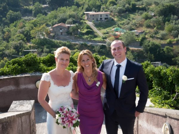 countryside wedding bride and groom with celebrant italy