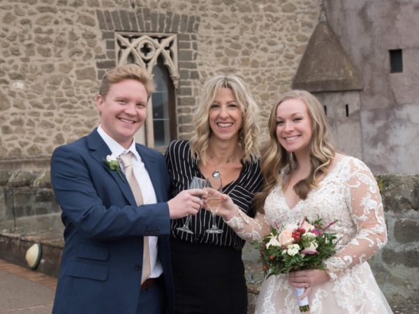 bride and groom toast with celebrant castle Italy wedding