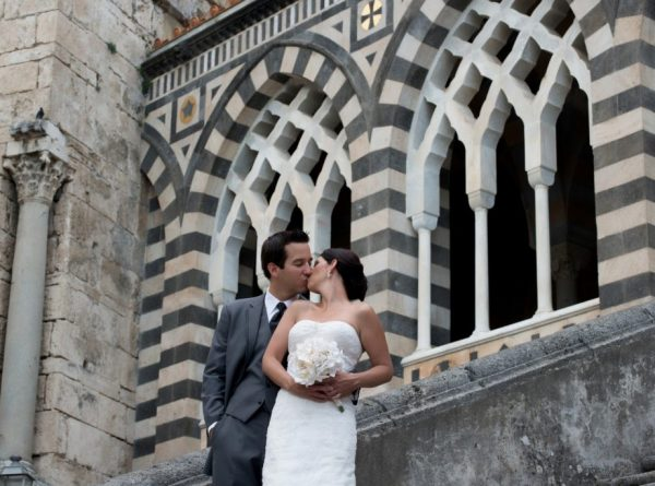Amalfi wedding photo shoot, bride and groom kiss at the Amalfi's Duomo