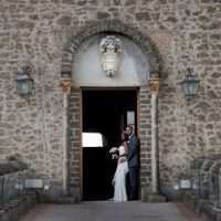 castle wedding exit with bride and groom