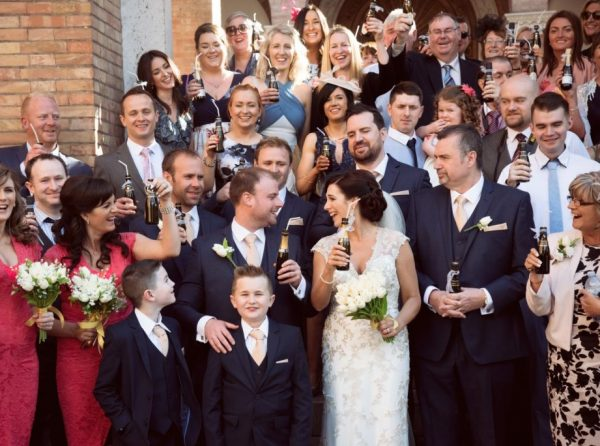 Church Wedding in Rome bride and groom toast with guests