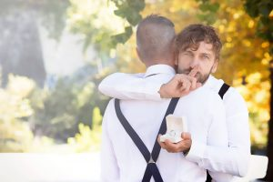 gay wedding proposal with engagement ring
